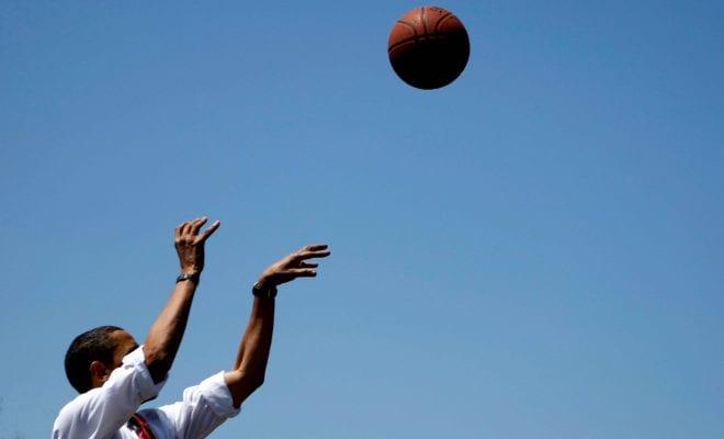 Obama shooting a basketball hoop