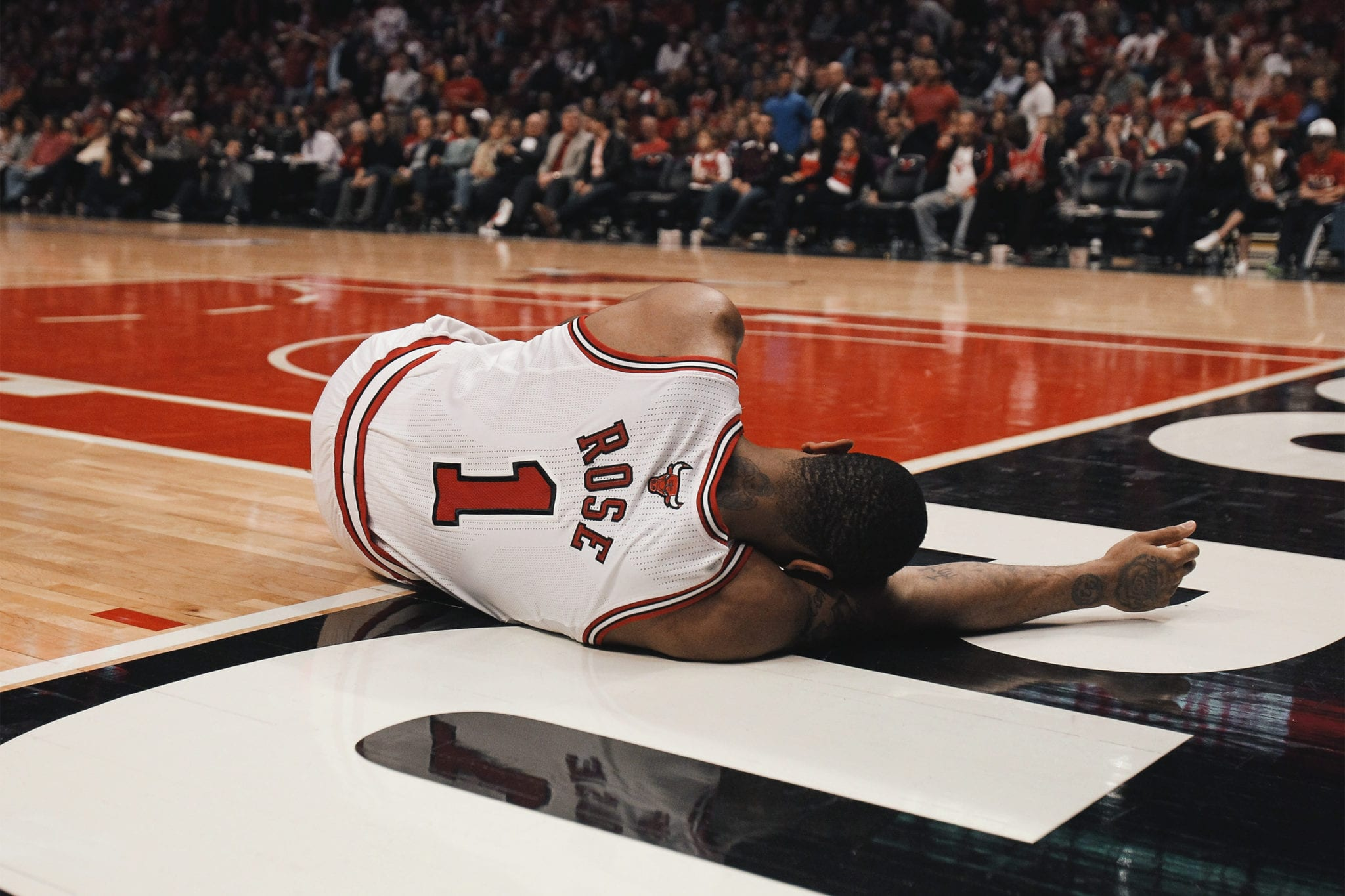 DEVASTATION: Derrick Rose in the moments after tearing his ACL in the second round of the 2012 Playoffs (April 28, 2012).
