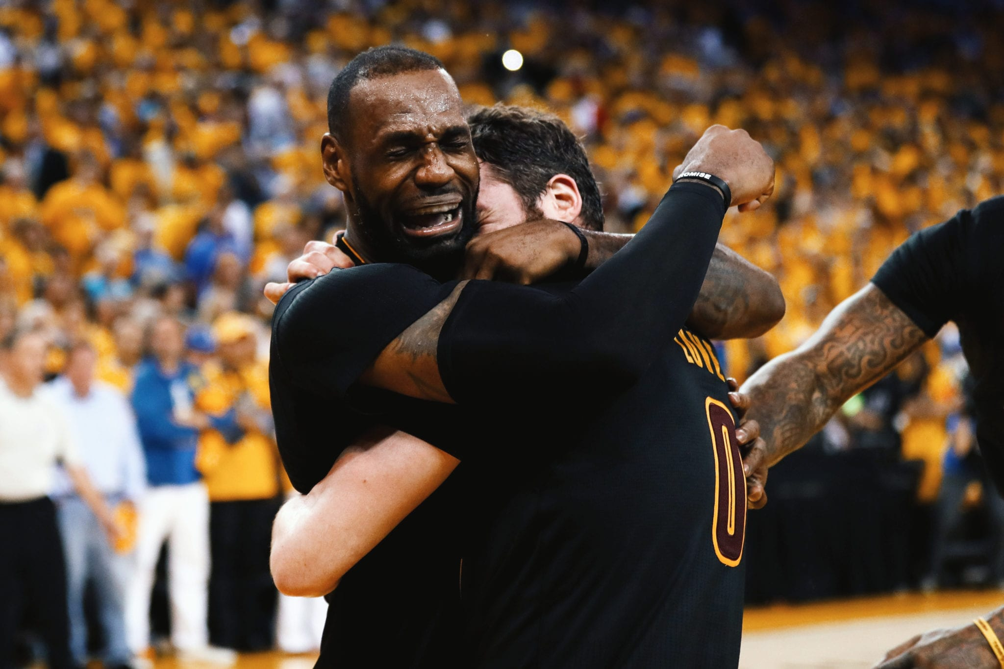 PROMISE KEPT: LeBron James embraces Kevin Love as the Cleveland Cavaliers come back from 3-1 down to win the 2016 NBA championship against the Golden State Warriors (June 19, 2016).