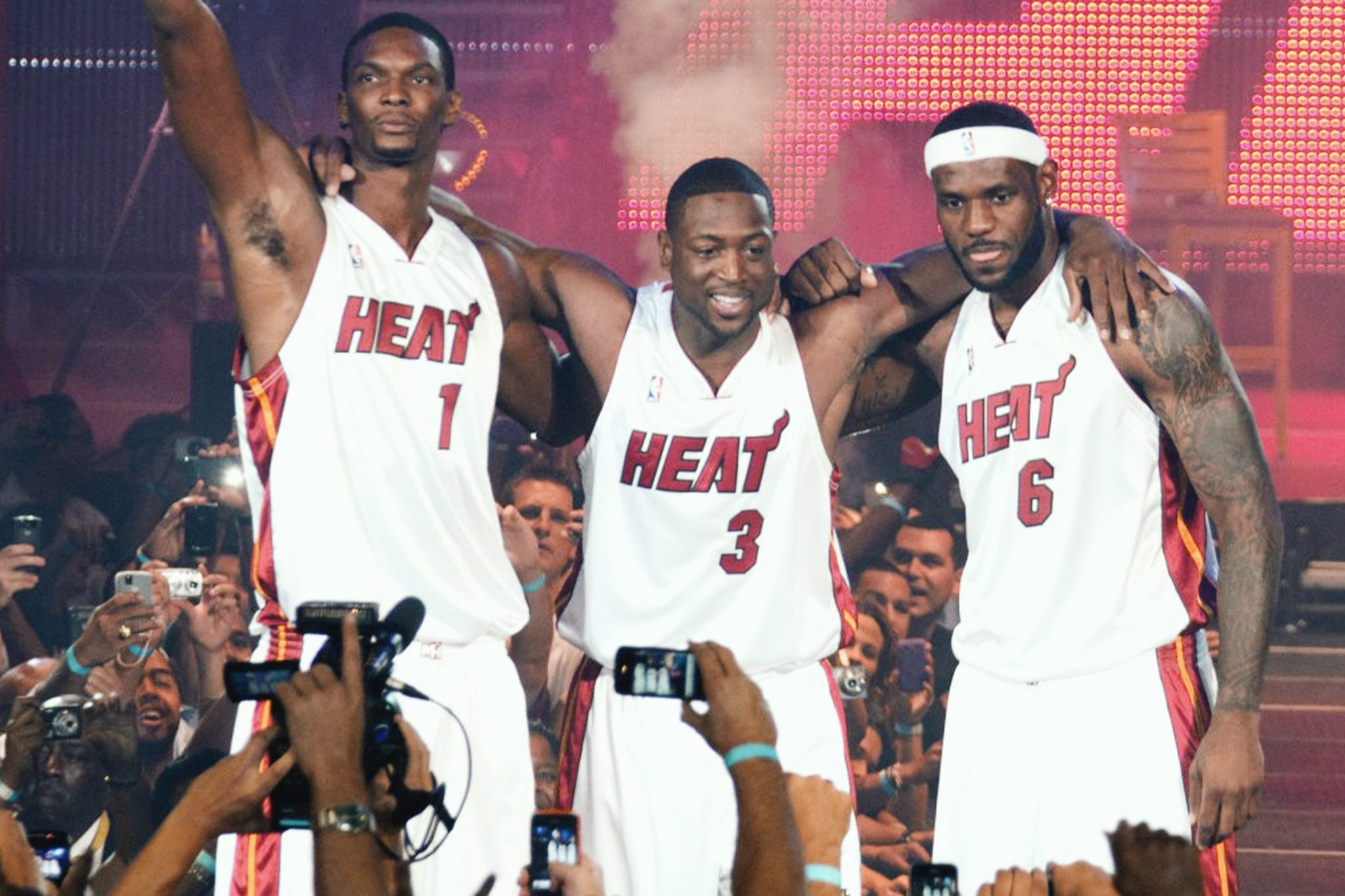 NOT ONE, NOT TWO, NOT THREE: Chris Bosh, Dwyane Wade and LeBron James live it up at the Miami Heat's Big 3 welcome party (November 20, 2010).
